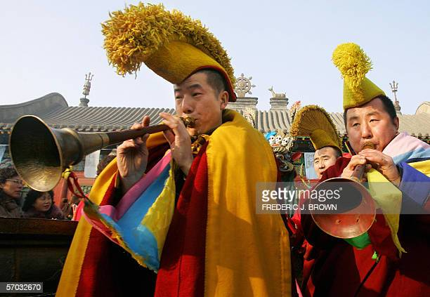 EthnicMongolian monks from the YellowHat sect of Tibetan Buddhism lead a procession marking celebrations of the Great Prayer festival or Monlam 11...