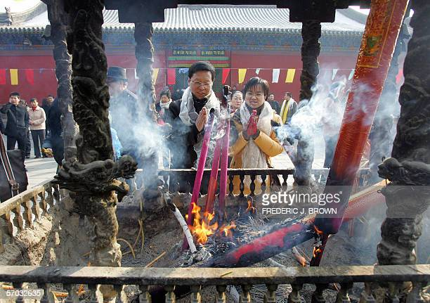 TO GO WITH AFPLIFESTYLECHINATIBETMONGOLIAFESTIVALRELIGION MORE ON IMAGE FORUM Worshippers pray at Dazhao temple in Hohhot where ethnicMongolian monks...