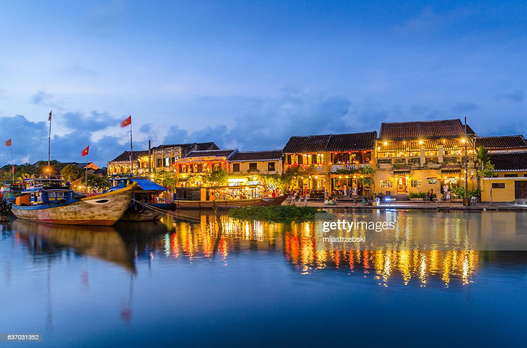 Hoi An reflected in the river during sunset : Stock Photo