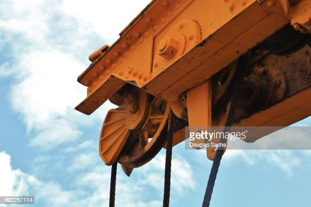 hoist crane with moving cable - sail boom stock pictures, royalty-free photos & images