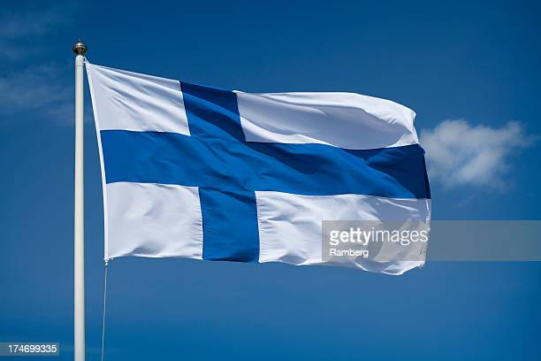 Hoisted Finnish flag with a blue sky background