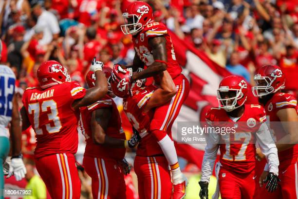 Hoisted into the air by Eric Fisher Dwayne Bowe of the Kansas City Chiefs celebrates with the team after scoring a touchdown against the Dallas...