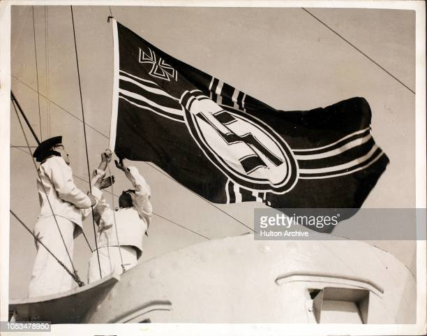 Hoisting the swastika flag aboard the German training ship 'SchleswigHolstein' after her arrival off Falmouth for an eight day visit England The...