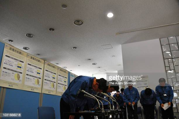 Hokkaido Electric Power Co executives attend a press conference at the company headquarters on September 11 2018 in Sapporo Hokkaido Japan A male...