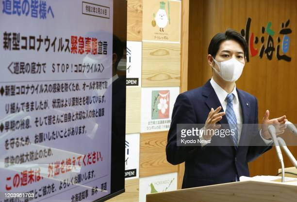 Hokkaido Gov. Naomichi Suzuki speaks at a press conference in Sapporo on Feb. 28 after declaring a state of emergency amid a rise in new coronavirus...