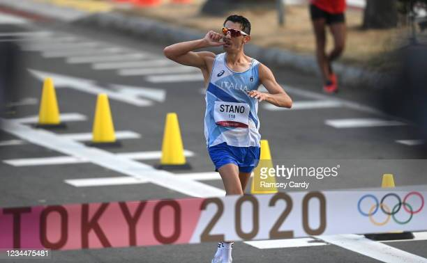 Hokkaido , Japan - 5 August 2021; Massimo Stano of Italy celebrates before crossing the finish line to win the men's 20 kilometre walk final at...