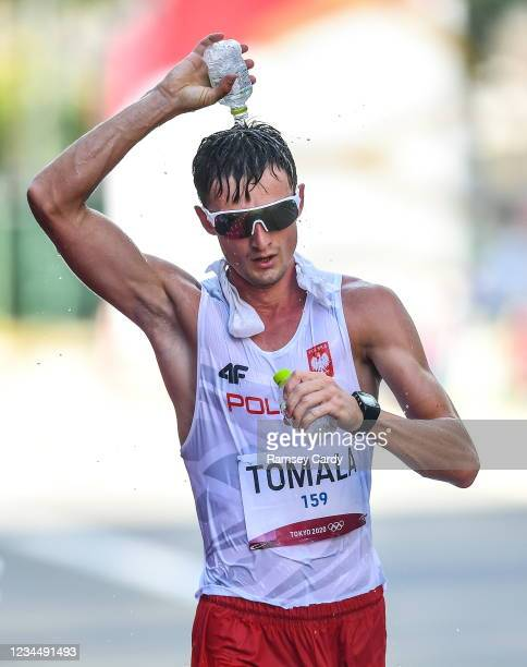 Hokkaido , Japan - 6 August 2021; Race leader Dawid Tomala of Poland uses water to cool himself during the men's 50 kilometre walk final at Sapporo...