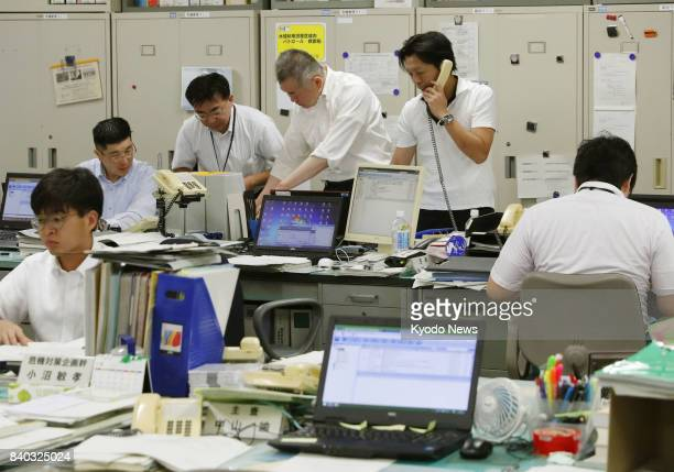 Hokkaido officials react at the local government building in Sapporo on Aug 29 after a North Korean ballistic missile passed over the Japanese...
