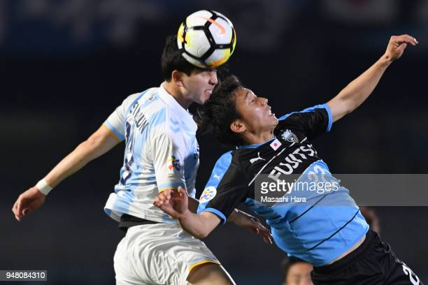Hokuto Shimoda of Kawasaki Frontale and Kim Seungjin of Ulsan Hyundai compete for the ball during the AFC Champions League Group F match between...