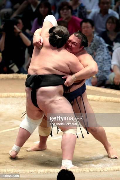 Hokutofuji pushes Mongolian ozeki Terunofuji out of the ring to win during day four of the Grand Sumo Nagoya Torunament at Aichi Prefecture Gymnasium...