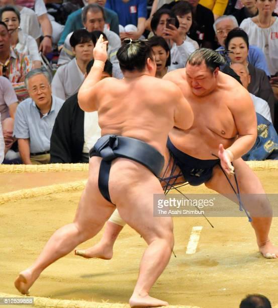 Hokutofuji pushes Mongolian yokozuna Kakuryu out of the ring to win during day three of the Grand Sumo Nagoya Torunament at Aichi Prefecture...