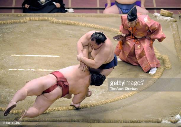 Hokutofuji throws komusubi Daieisho to win on day nine of the Grand Sumo July Tournament at the Ryogoku Kokugikan on July 27 2020 in Tokyo Japan