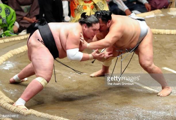 Hokutofuji throws Mongolian ozeki Terunofuji to win during day one of the Grand Sumo Autumn Tournament at Ryogoku Kokugikan on September 10 2017 in...