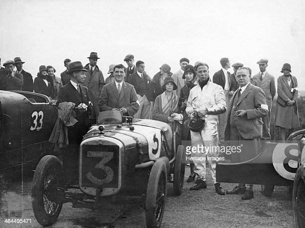 SV Holbrook winner of the 500 Miles Race Brooklands Surrey Sidney Holbrook in racing gear is pictured standing next to his father Sam Austin's Sales...