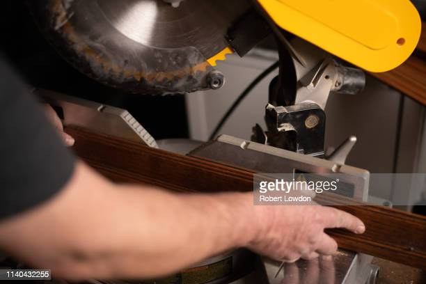 hold board for cut - mitre stock pictures, royalty-free photos & images