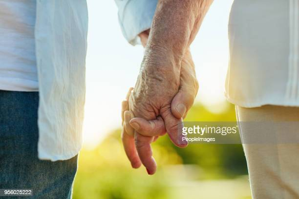 hold my hand and let's make it last - holding hands stock pictures, royalty-free photos & images