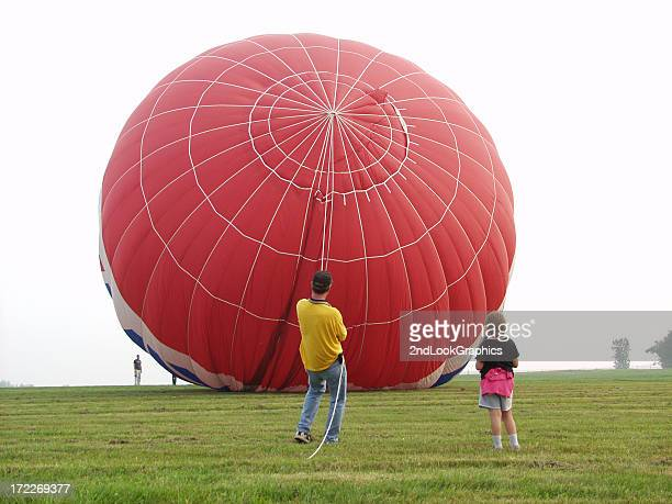 hold on to that balloon - dragging stock pictures, royalty-free photos & images