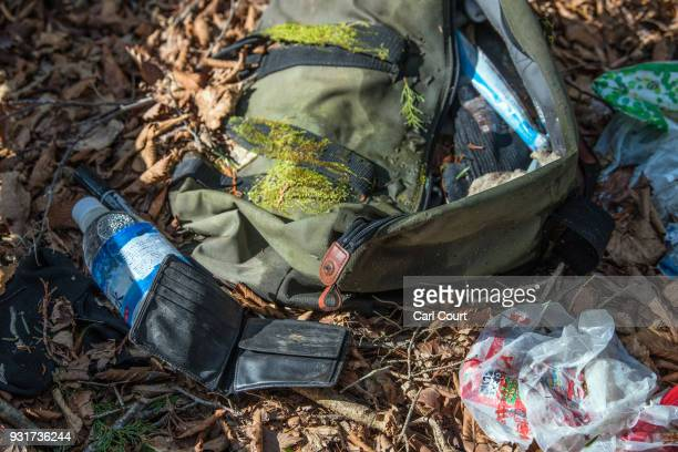 A holdall and items including clothing and a wallet remain at the scene of an apparent suicide in Aokigahara forest on March 13 2018 in...