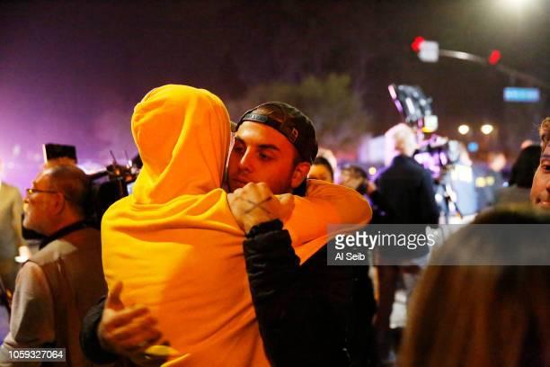 Holden Harrah left hugs Matt Wennerstom right as both men witnessed the shooting at the Borderline mass shooting on November 8 2018 in Thousand Oaks...