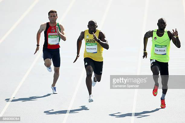 Holder da Silva of GuineaBissau Wilfried Bingangoye of Gabon and Abdul Wahab Zahiri of Afghanistan competes in the Men's 100m Preliminary Round on...