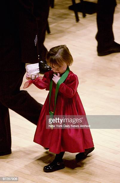 Holdin her father's hand, Patricia Smith leaves the stage wearing the Medal of Honor awarded posthumously to her mother, at the Police Department's...