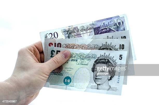 holding 45 pounds - ten pound note stock photos and pictures