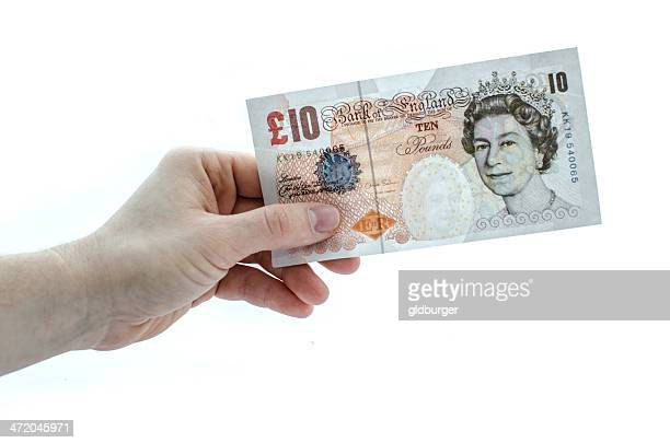 holding a 10 pound note - ten pound note stock photos and pictures