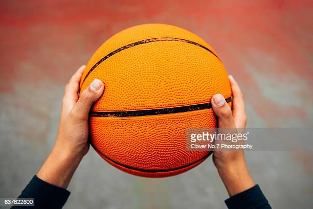 Holding a basketball hand, POV.