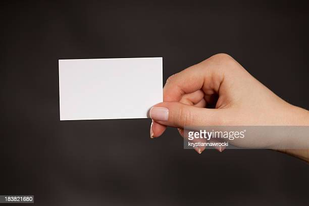 Holding a blank white business card