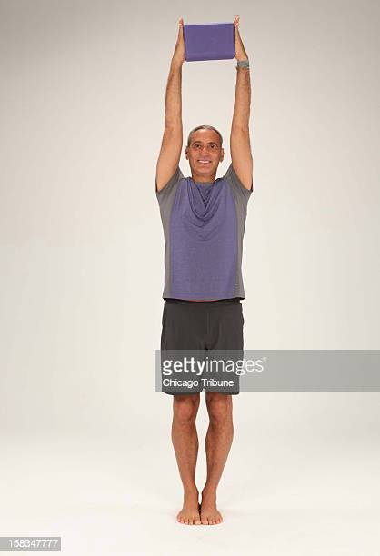 Holding a block between your hands will help to target your side torso muscle more effectively in this side bend Often we cheat when bending from...