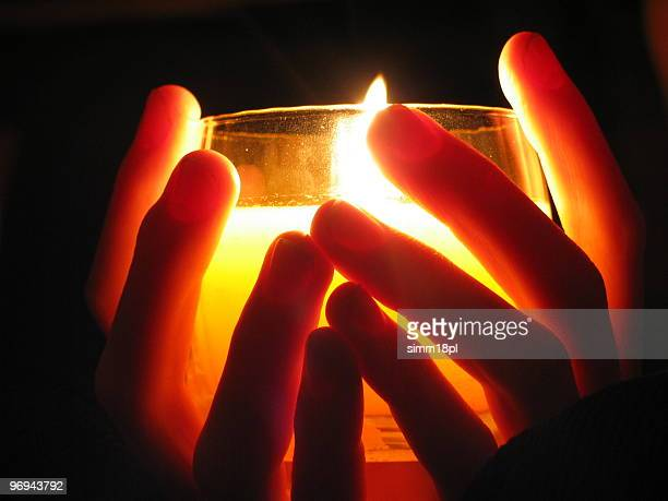 holding a candle in darkness