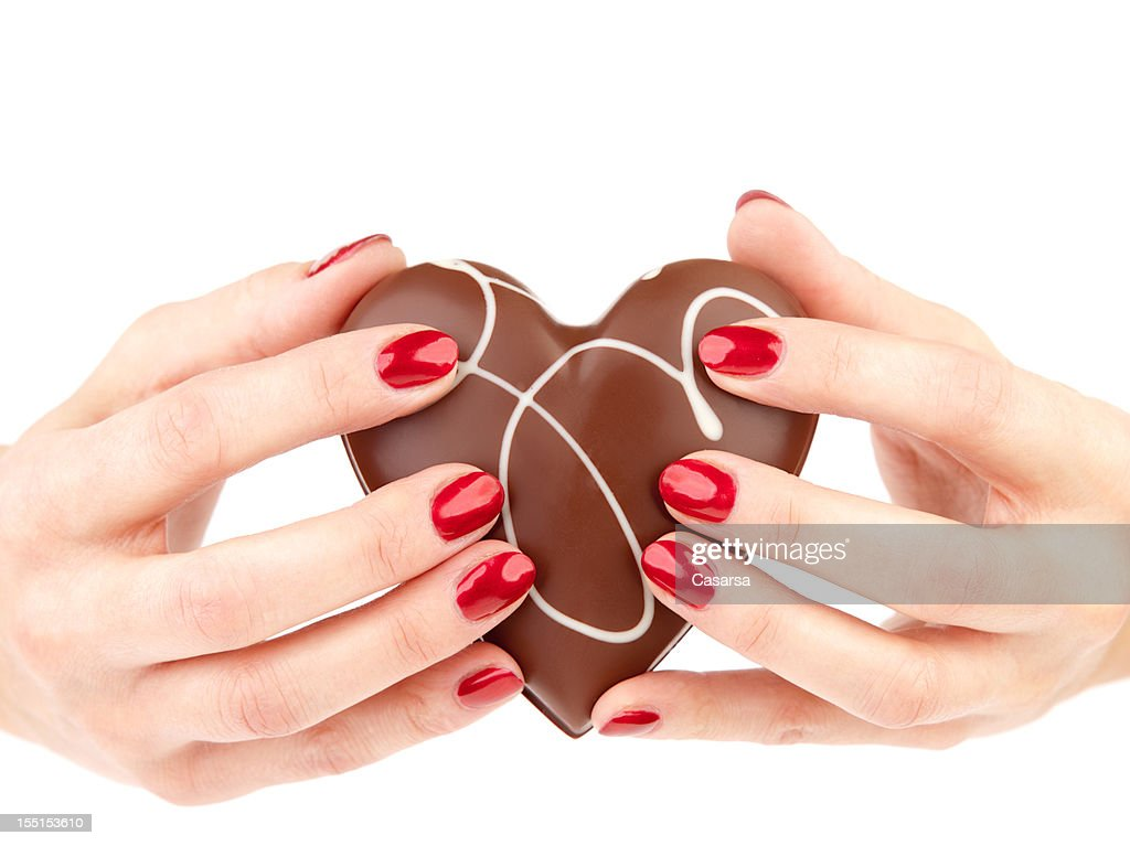 Holding a chocolate heart : Stock Photo