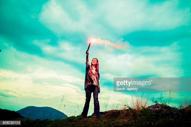 Holding a flaming torch on mountain