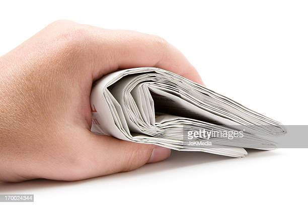 Holding a Folded Newspaper