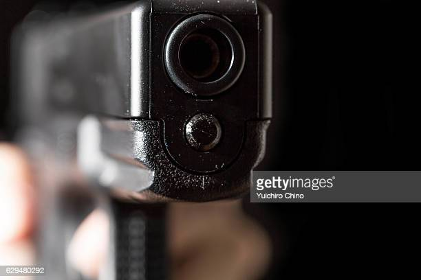 Holding a gun on black background