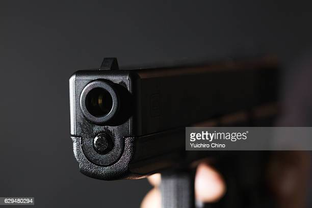 Holding a gun on black background