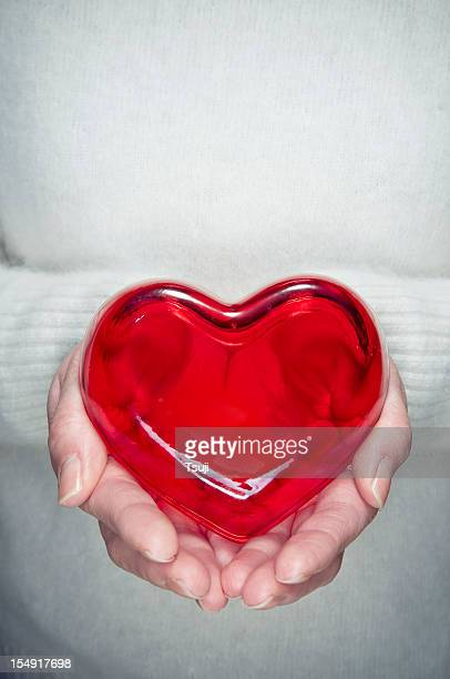 holding a heart - heart month stock photos and pictures