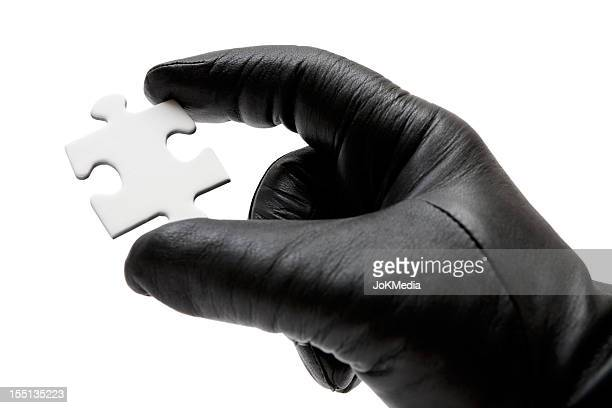 holding a jigsaw piece - leather glove stock pictures, royalty-free photos & images