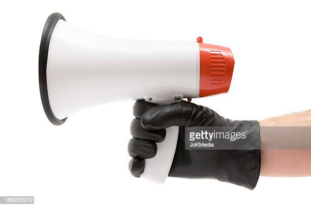 holding a megaphone - black glove stock pictures, royalty-free photos & images