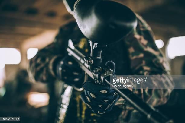 Holding a paintball gun