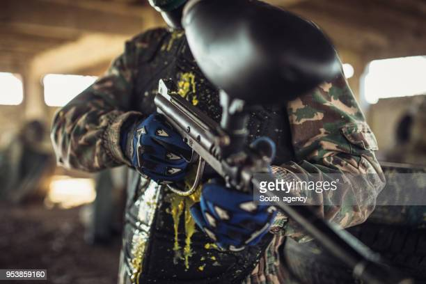 Holding a paintball gun