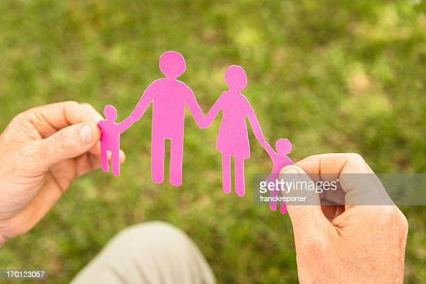 Holding a paper doll family