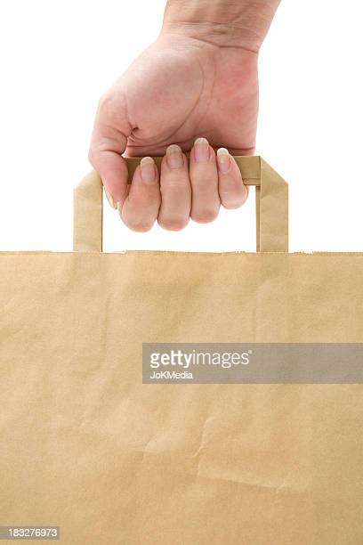 Holding A Paper Shopping Bag