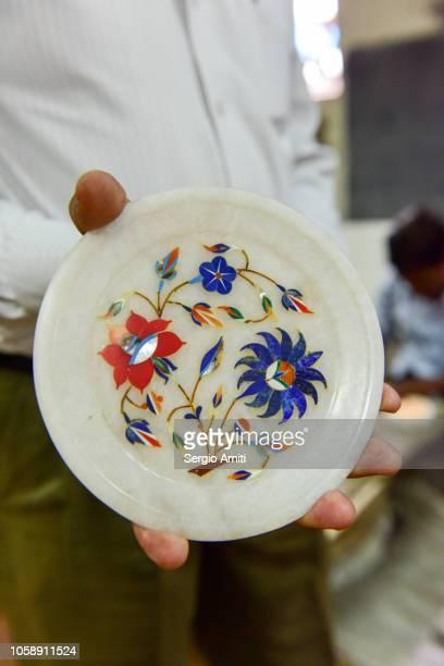 Holding a pietra dura artwork