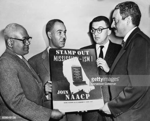 Holding a poster against racial bias in Mississippi are four of the most active leaders in the NAACP movement from left Henry L Moon director of...