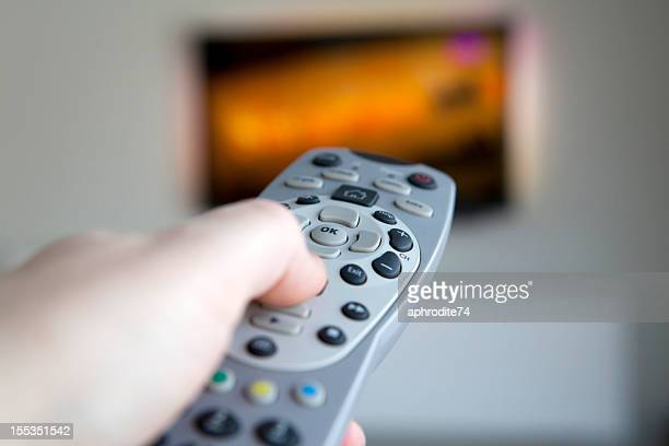 holding a remote control