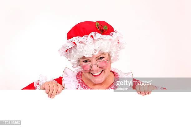 hält ein schild - weihnachtsfrau stock-fotos und bilder