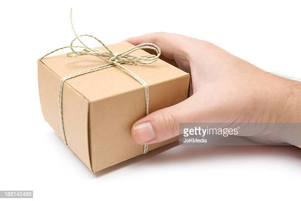 Holding a Small Decorated Packet