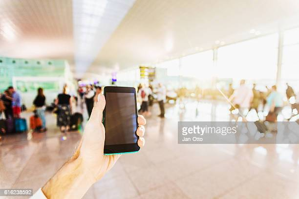 Holding a smartphone on airport