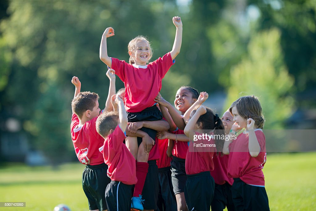 Holding a Teammate Up in the Air : Stock Photo